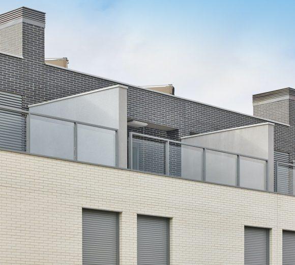 New building exterior facade attics with terrace. Construction. Buy, rent